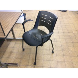 Black plastic  side chair on castors (3/5/2020)