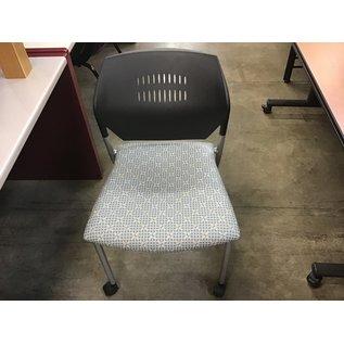 Lt. green metal chair on castors (10/14/20)