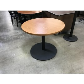 "36"" Round Light oak table on platform (1/20/21)"