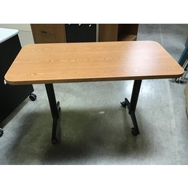 "24""x48""x29"" Lt. Oak table w/ metal frame on castors (1/21/21)"