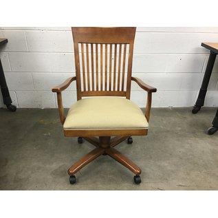 Wood slot back lt. Brown  chair  on castors (4/1/2021)