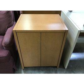 "20x24x29 1/2"" Oak color wood 2 door cabinet w/chip on top back corner 10/19/21"