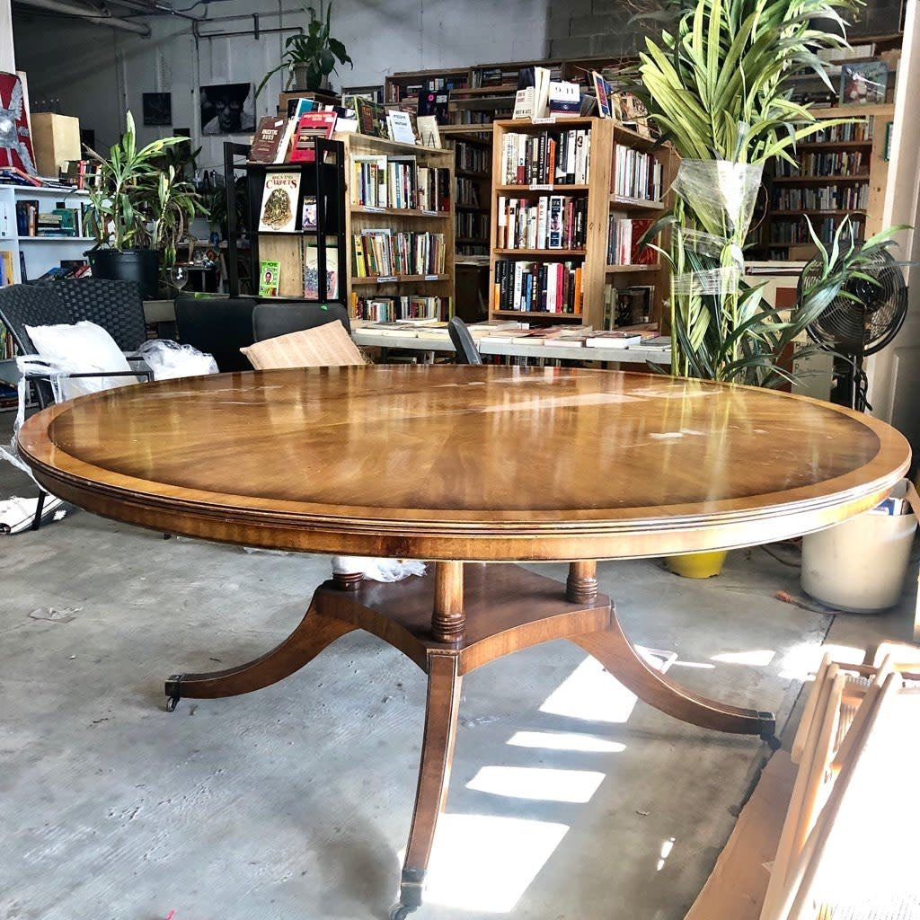 Antique Maple Round Table with Brass Wheels
