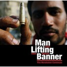 Man Lifting Banner - The Revolution Continues (Discography) LP
