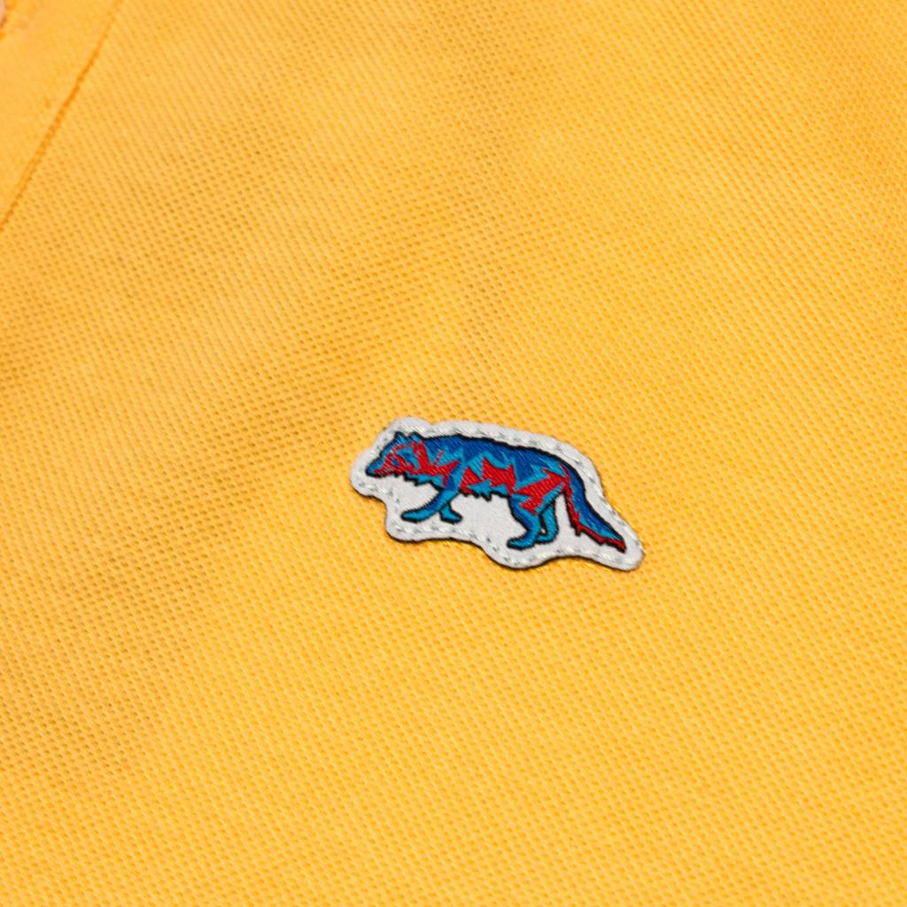 Raised By Wolves Raised by Wolves Geowolf Polo Old Gold