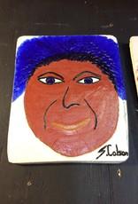 Cast stone plaque face w/ blue hair