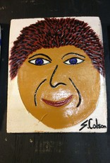 Cast stone plaque face w/ red hair