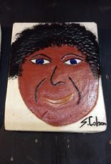 Cast stone plaque face w/ black hair