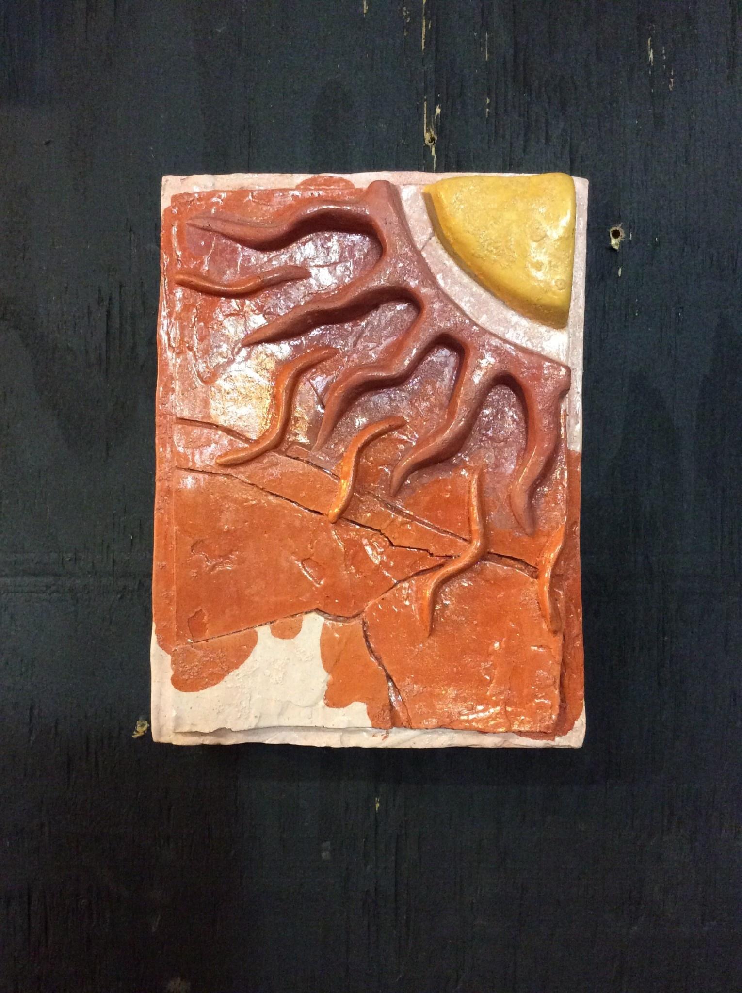 Cast stone orange red yellow sun plaque