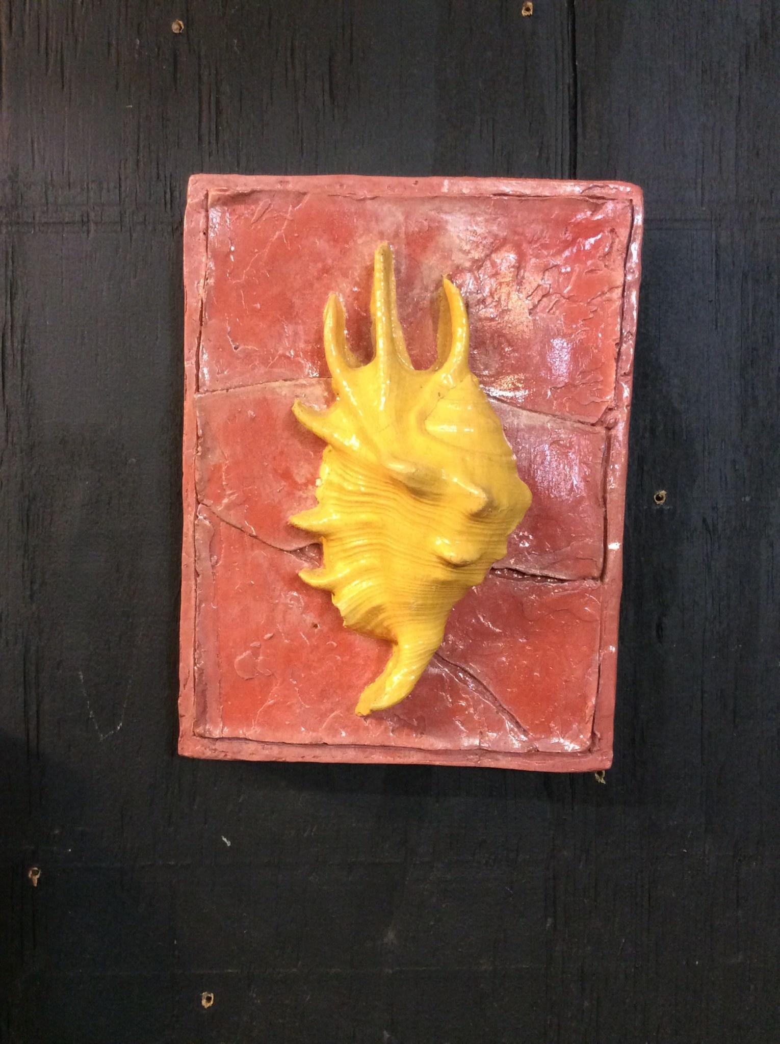 Cast stone yellow sea shell plaque