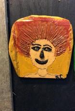 Cast stone yellow plaque portrait