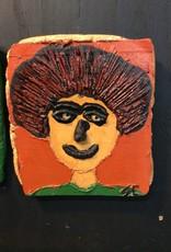 Cast stone orange plaque portrait