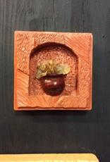 Cast stone potted plant plaque