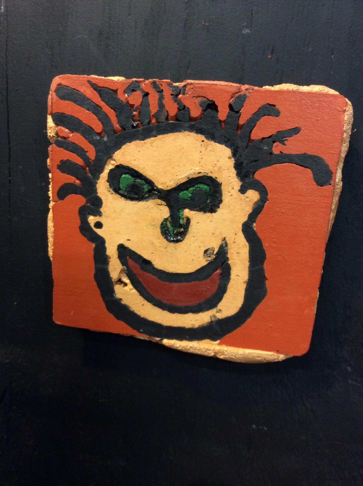 Cast stone crazy face plaque