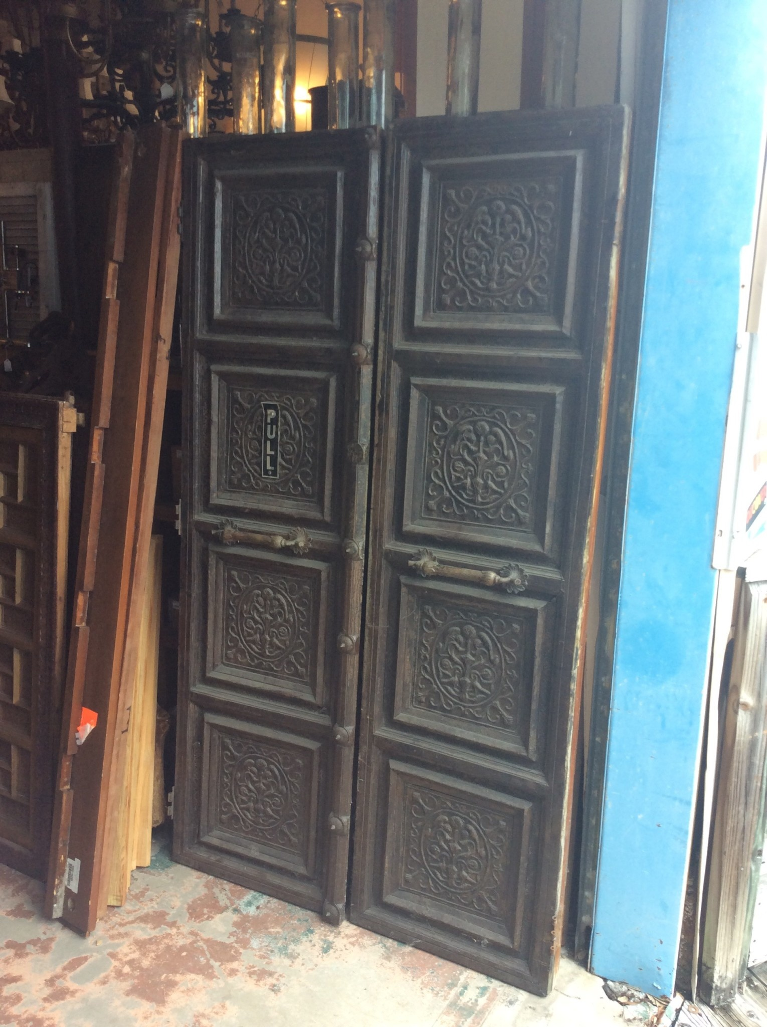 Brass and wood carved door