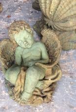 Angel Boy Sitting On Basket