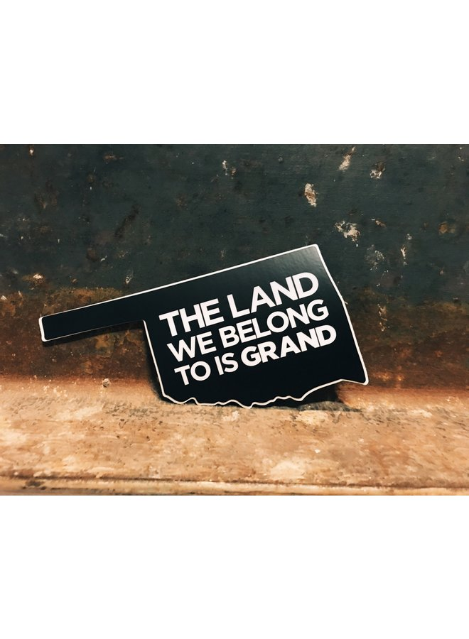 The Land We Belong To Is Grand Sticker