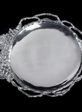 Arthur Court Designs Grape Vine Round Tray<br /> Twisting, openwork vines transition into a detailed collection of grapes and leaves on the edge of this handmade, aluminum dish. The lines defining the shape of the fruit and the marks in the vegetation form a textured border around