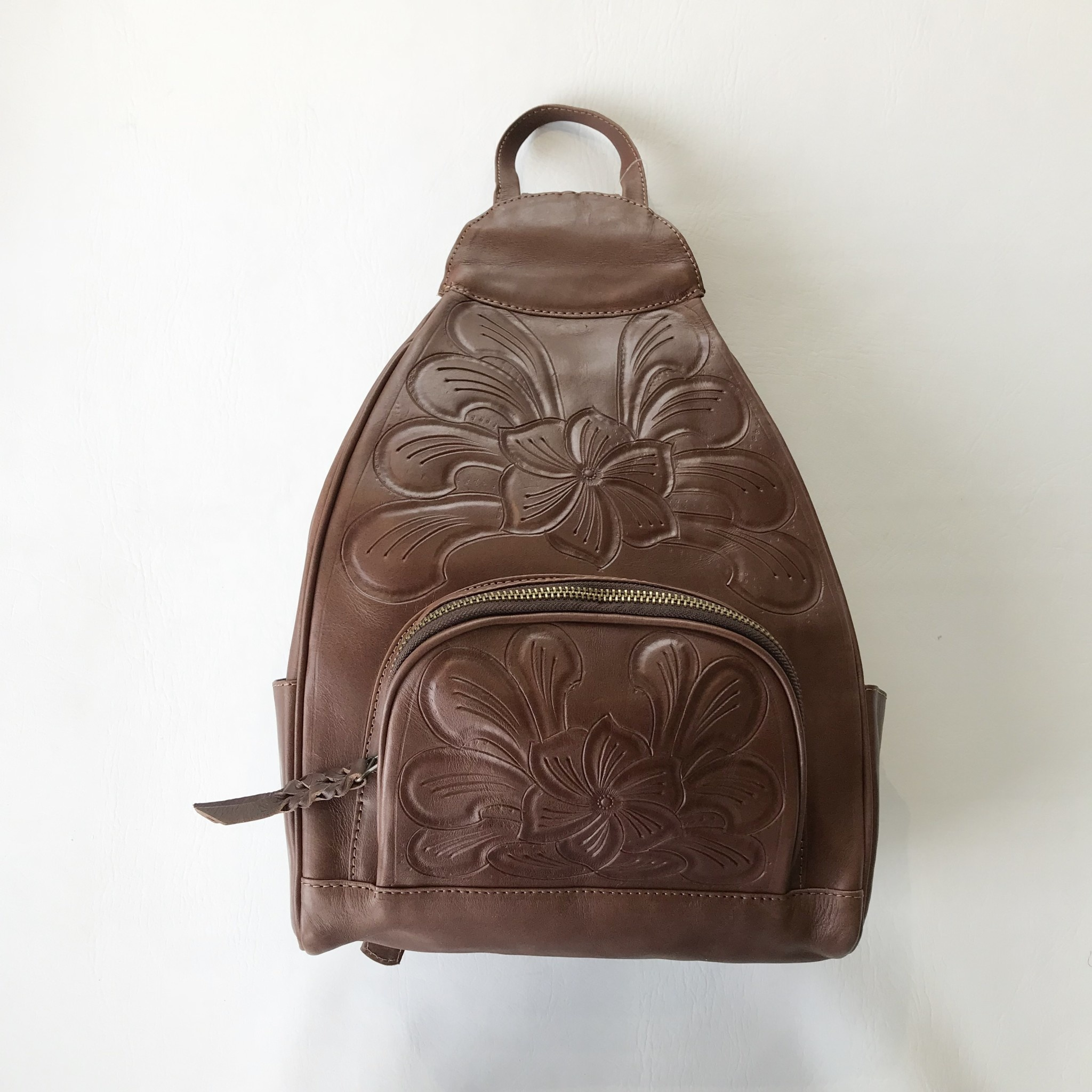 waxed leather tooled mini backpack L.L.