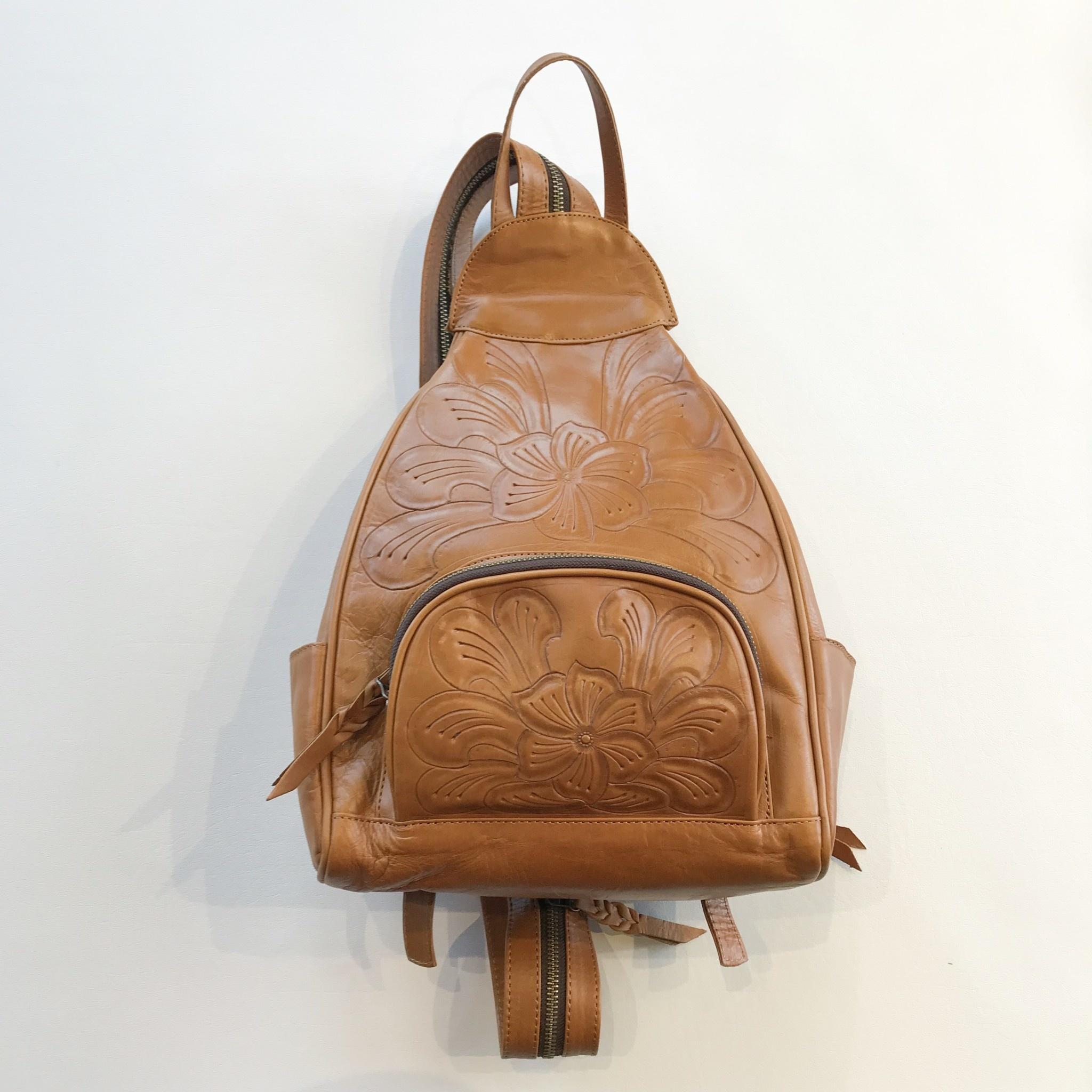 303df0bb3ca waxed leather tooled mini backpack
