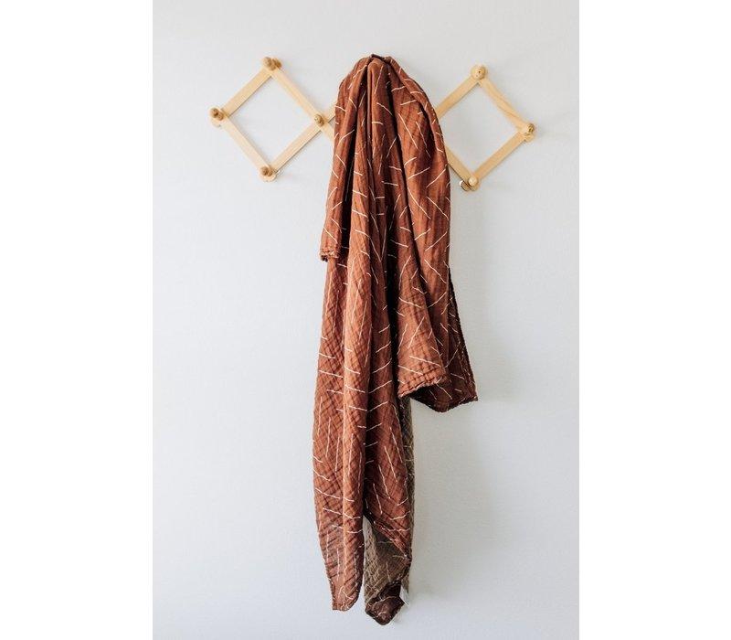 Rust mudcloth swaddle blanket