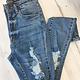 Dogma Medium Wash Distressed Skinny Jeans