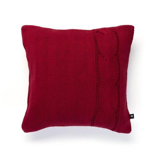 Coussin rouge en tricot