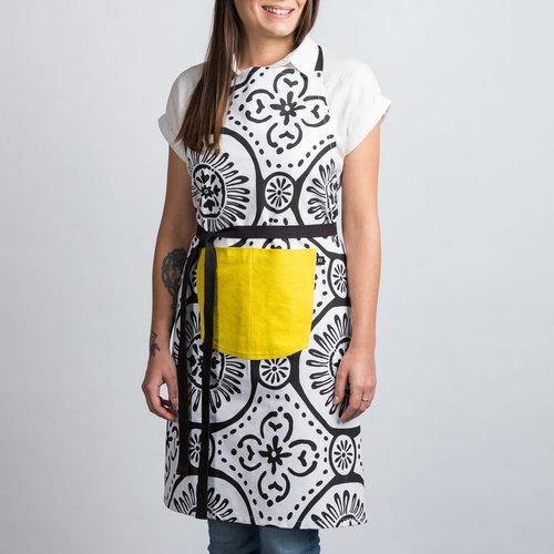 Tablier blanc à motifs noirs et à pochette jaune