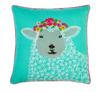 Coussin avec mouton et fleurs brodés