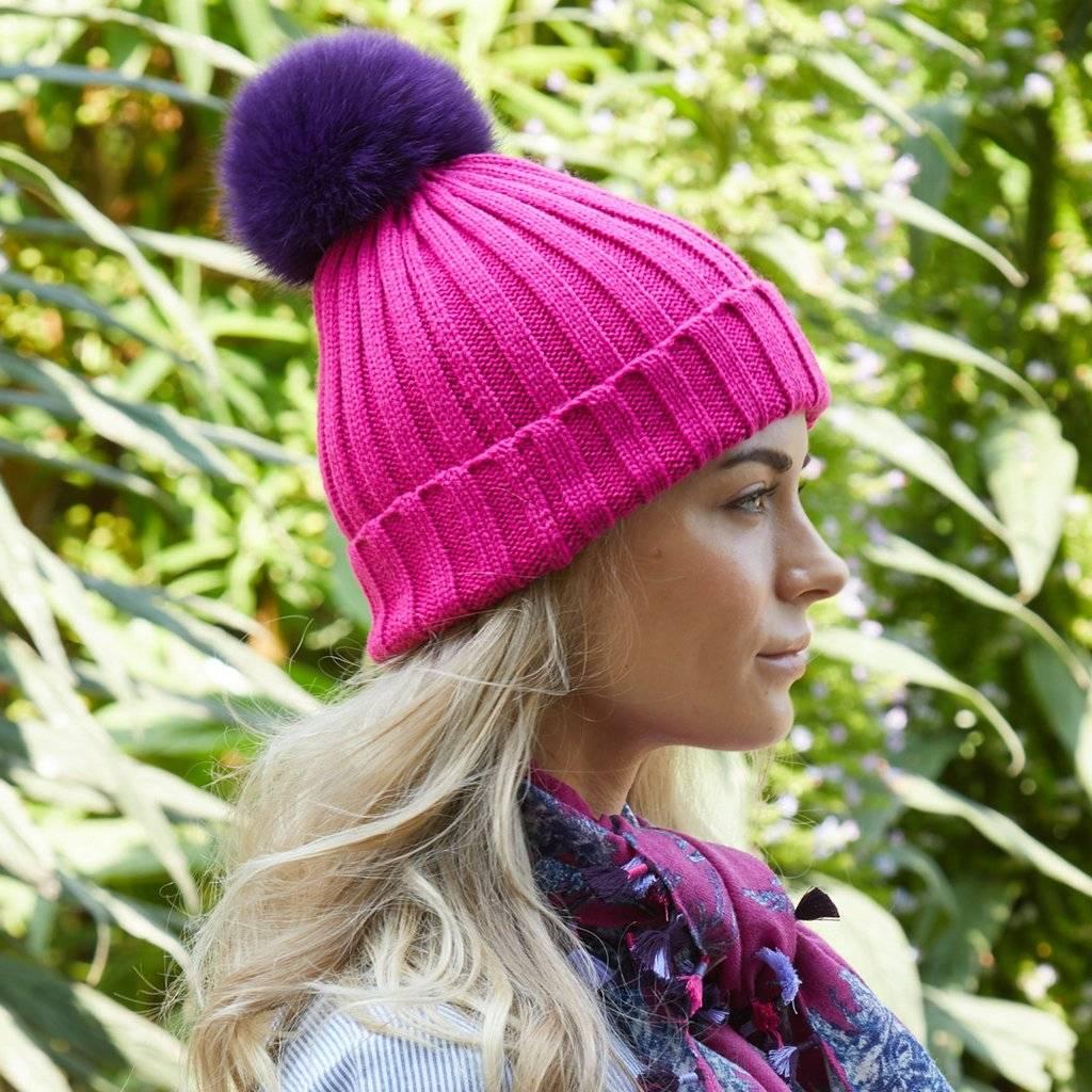 446de9cd063 Fun hand-knit hats with interchangeable fur poms!