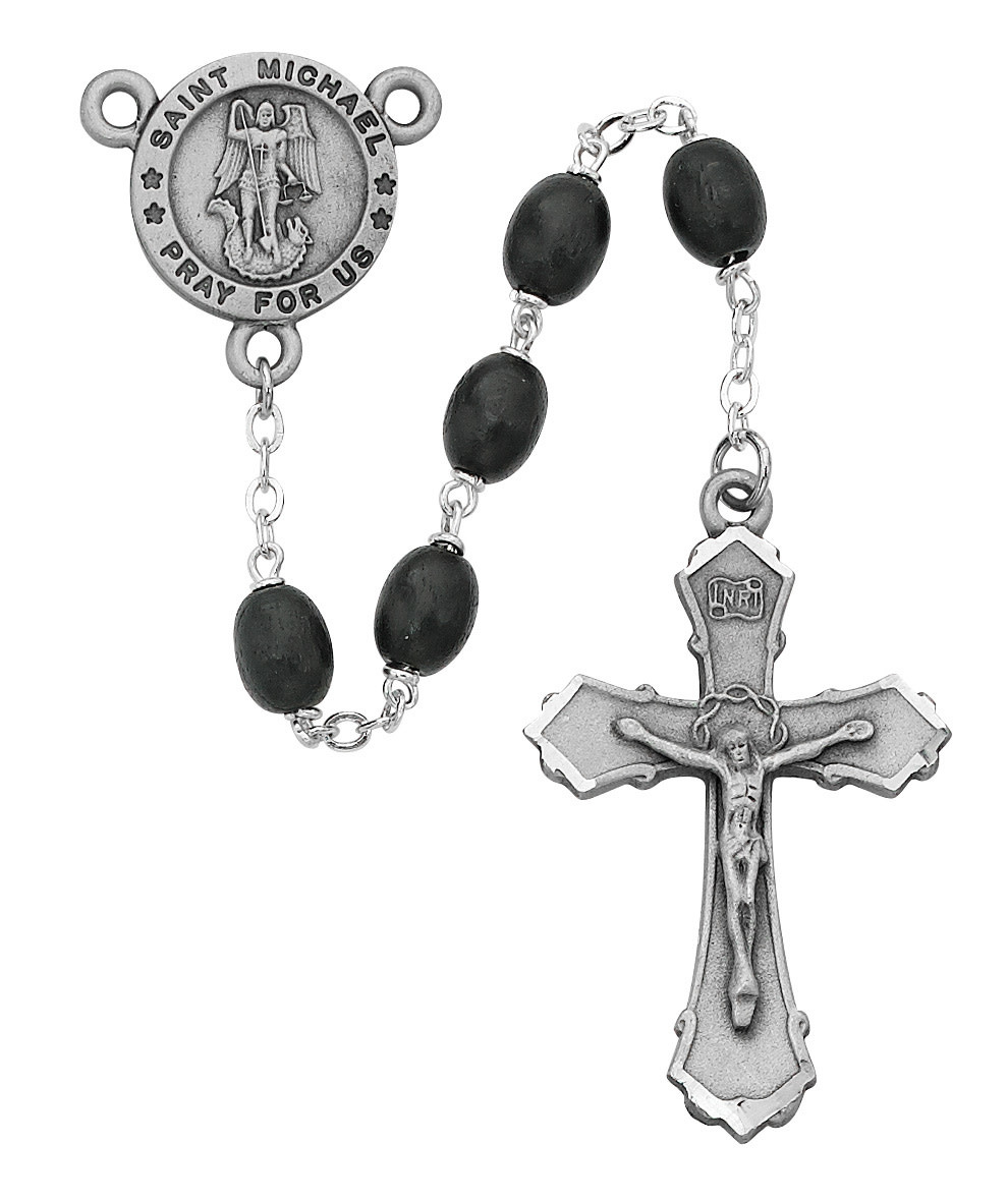 McVan Black Wood St Michael Rosary Boxed - 6x8mm black wood beads with pewter crucifix and St Michael center. Deluxe gift boxed