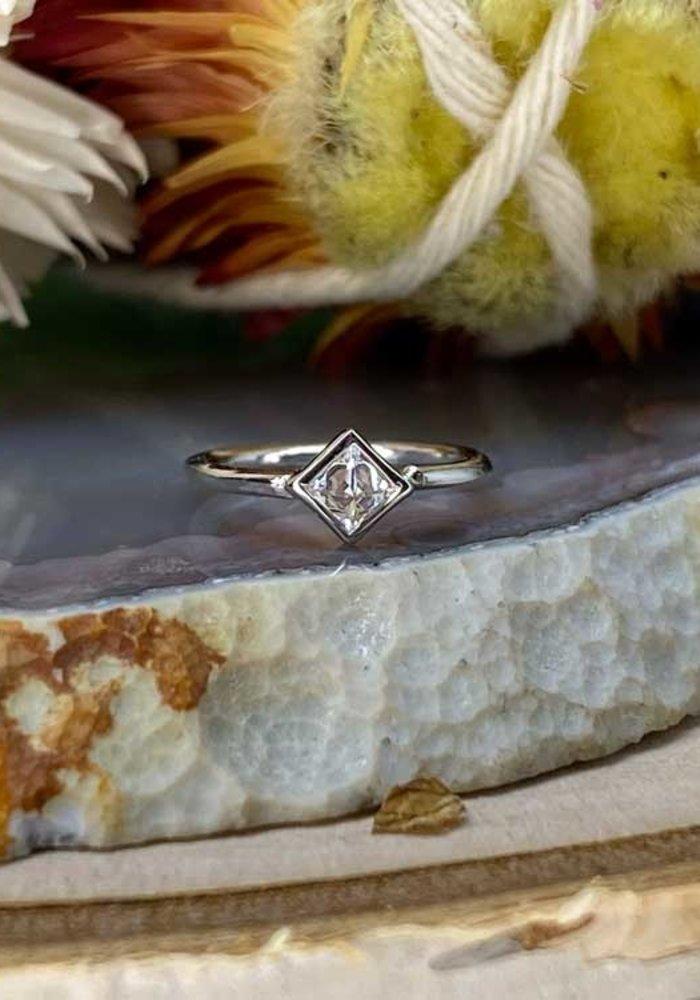 "Buddha Jewelry Organics Mae White Gold with Reverse-Set White CZ 18g 5/16"" Seam Ring"