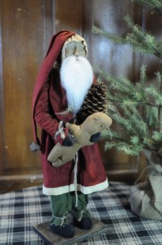 Arnett's Arnett's Santa with Red Coat Holding Gingerbread & Pinecone TYC2