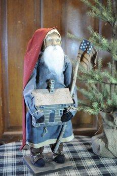 Arnett's Arnett's Santa Blue Coat Holding Cabin & Flag TYC6
