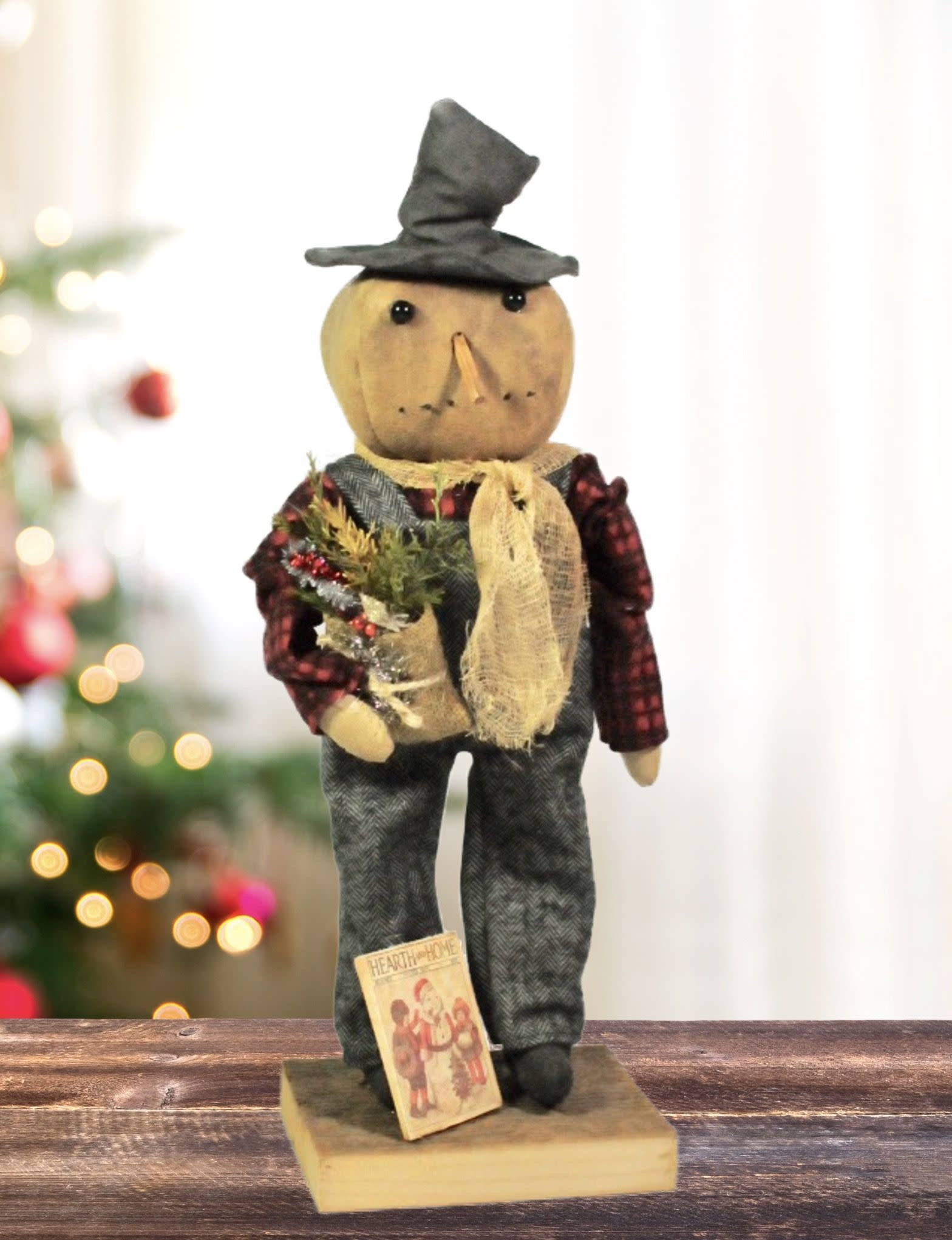 Grungy Snowman Holding Pouch & Book