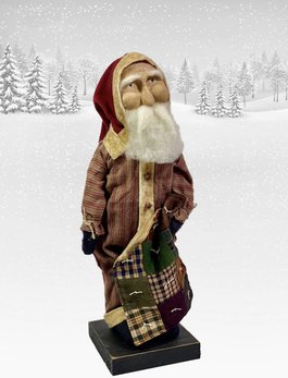 Nana's Farmhouse Primitive Santa in Ticking Union Suit holding Quilt
