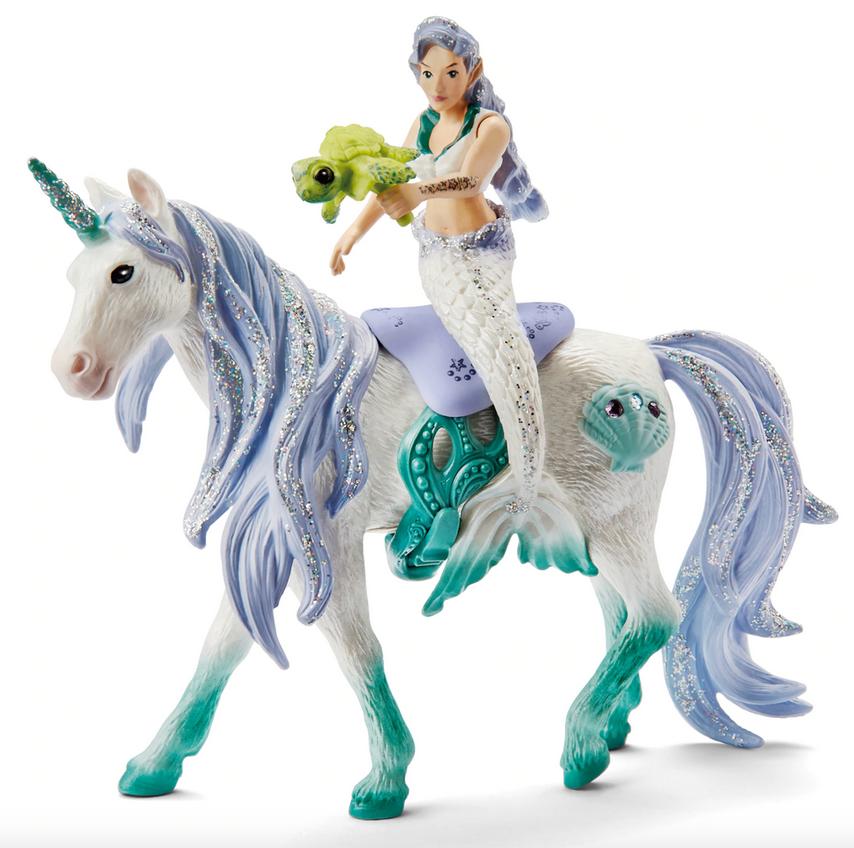 Mermaid riding on sea unicorn