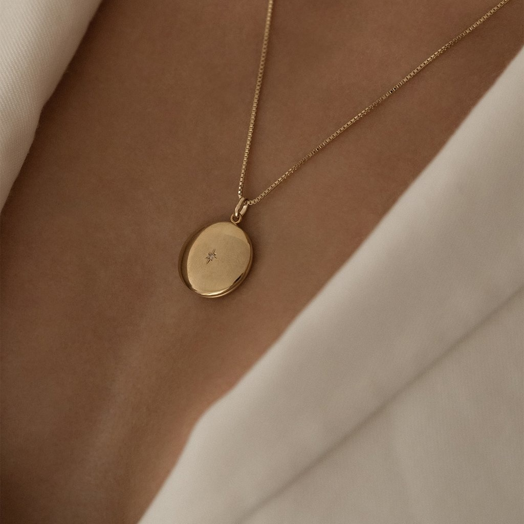 Gold FilledLocket with tiny diamond