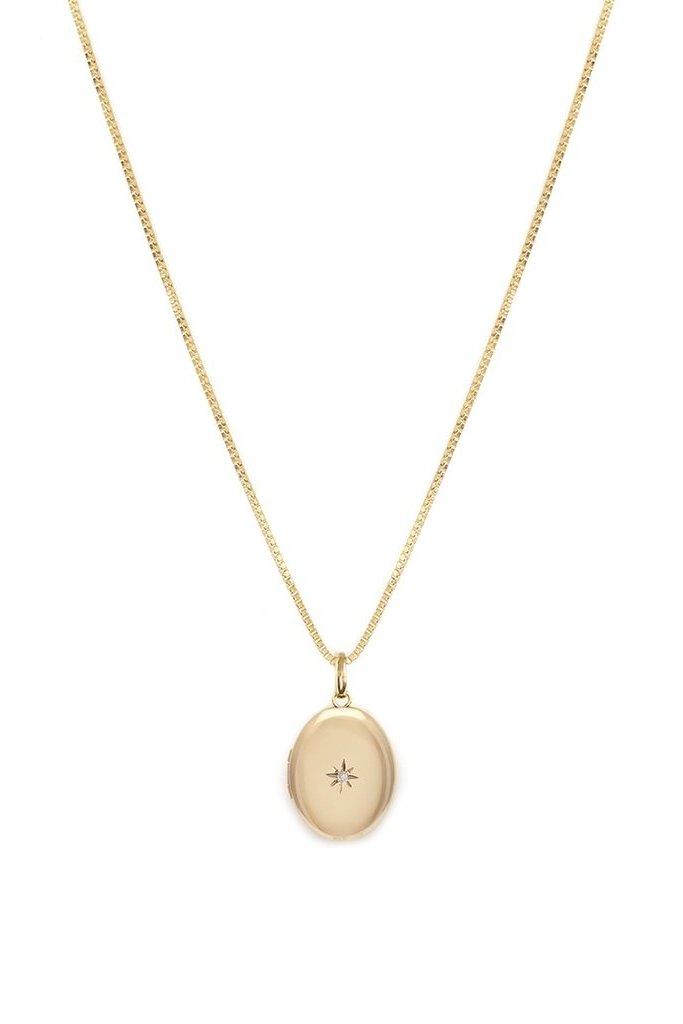 Gold Oval  Locket with tiny diamond