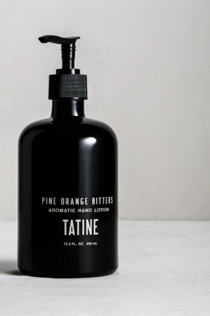 Tatine Pine Orange Bitters Hand Lotion in Glass Bottle
