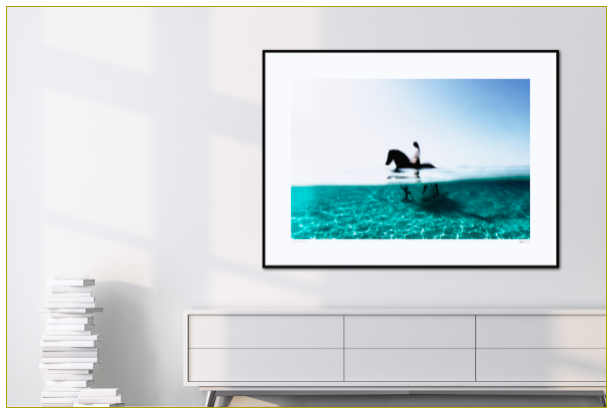 For a relaxed family room design, hanging a seascape photograph helps creating a calming environment.