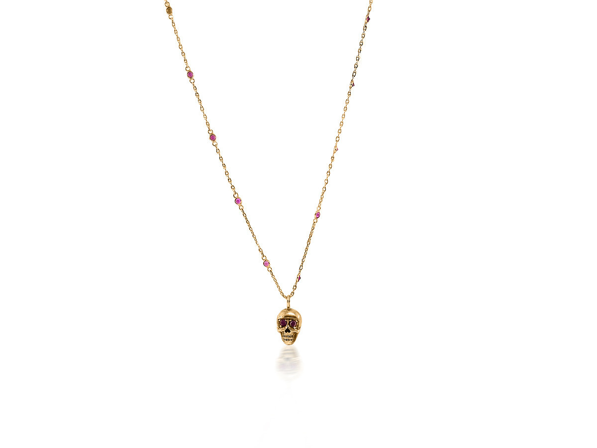 Trabert Goldsmiths Delicate Bezel Set Ruby Necklace With Skull Pendant