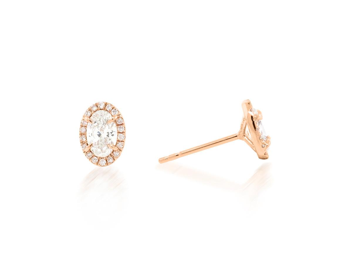 Trabert Goldsmiths 0.70ct Oval Diamond Halo Stud Earrings