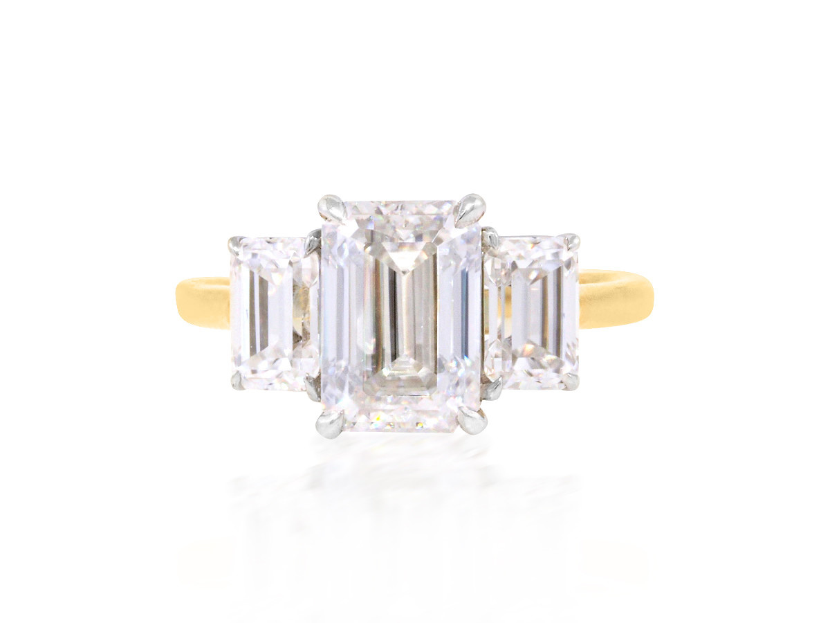 Trabert Goldsmiths 2ct Emerald Cut Moissanite Trinity Ring
