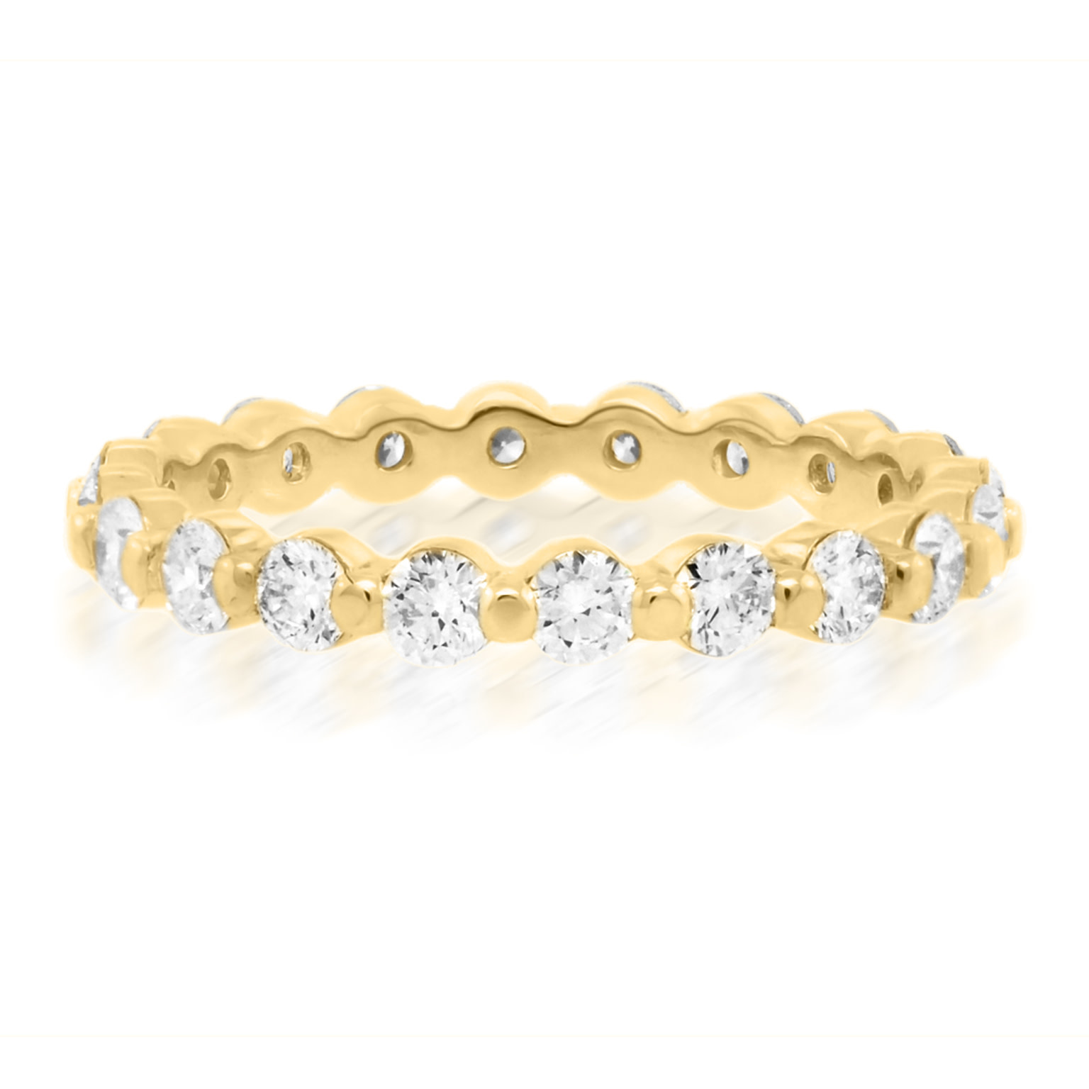 Trabert Goldsmiths Celeste Gold Diamond Shared Prong Band