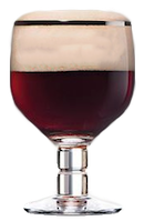 A goblet beer glass filled with a Chimay beer.