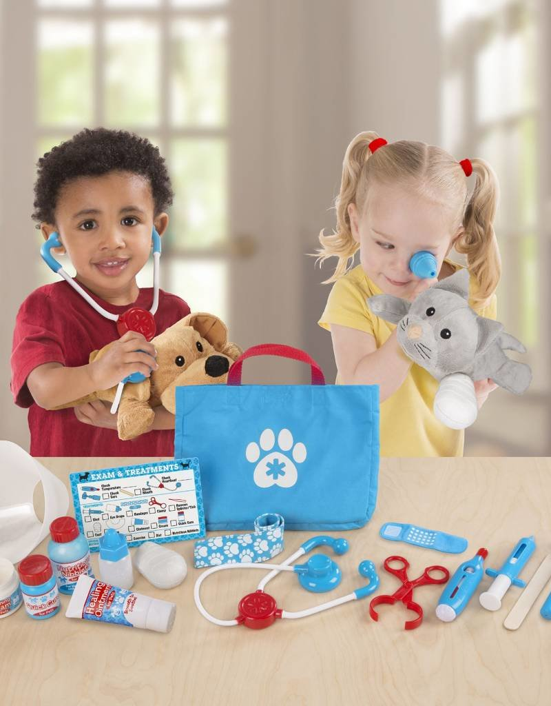 Melissa & Doug, LLC examine and treat pet vet play set