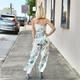 She & Sky Wide Leg Jumpsuit with Side Slit and Waist Sash