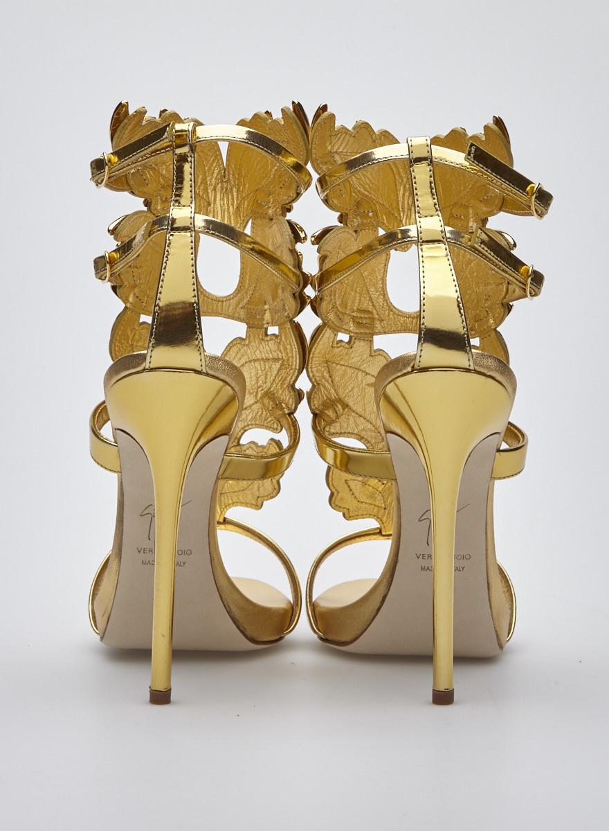 Giuseppe Zanotti Design Sandales à talons dorées en cuir verni avec feuille dorées