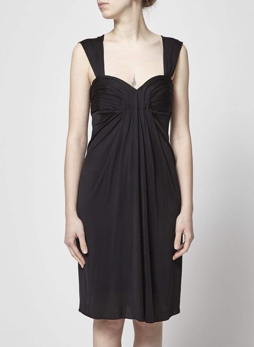 4ed9f4006e2 Les petites Robe de soirée noire drapée .
